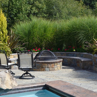 Example of a classic patio design in Portland with a fire pit