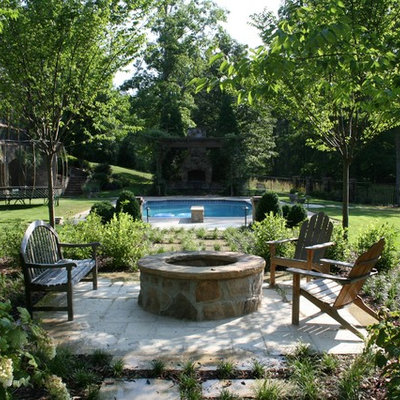 Elegant patio photo in Birmingham with a fire pit