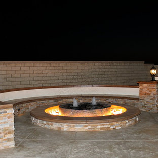 Inspiration for a huge contemporary backyard stamped concrete patio remodel in Los Angeles with a fire pit