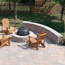 """Firepit - A Techo-Bloc """"Valencia"""" fire pit on a """"Blu 60"""" paver patio, with seating wall."""