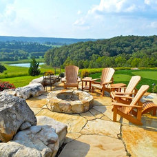Rustic Patio by Forte Building Group, LLC