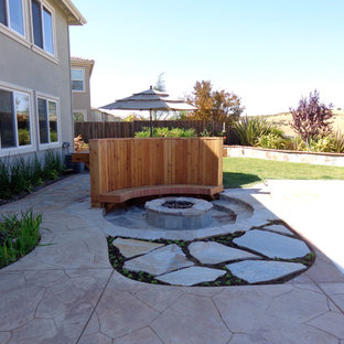 Example of a mid-sized classic backyard stone patio design in San Francisco with a fire pit and no cover