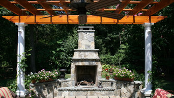 Flagstone patio with fireplace and pergola - Oak Hill, VA