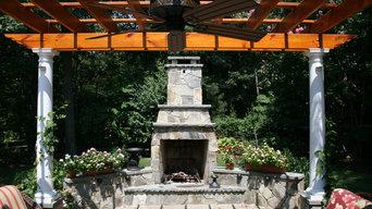 Flagstone patio with fireplace and pergola - Oak Hill, VA