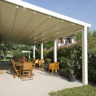 Photo of a medium sized classic back patio in New York with decking and an awning.