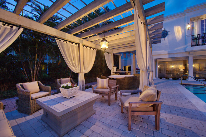 Mediterranean Patio by Clifford M. Scholz Architects Inc.