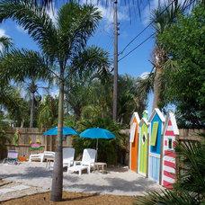 Tropical Patio by Pamela DeCuir Interior Designs