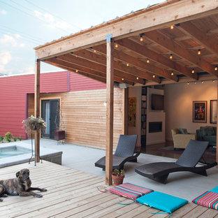 Inspiration pour une terrasse et balcon design avec une pergola.