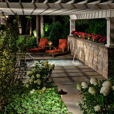 Example of a classic patio fountain design in Chicago with a pergola