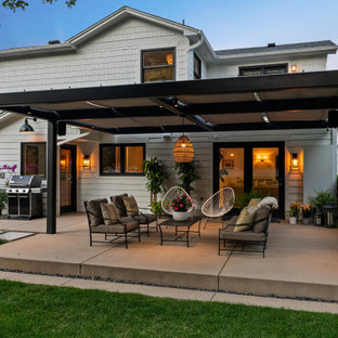 Country concrete patio photo in Denver with a gazebo