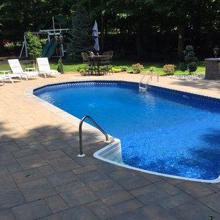 Example of a classic backyard patio design in Newark