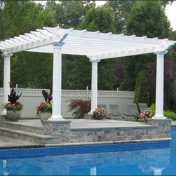 Freestanding Pergola - Crafted in low maintenance cellular vinyl with fiberglass Tuscan columns, this dignified pergola brings depth, style, and partial shade to a poolside setting.