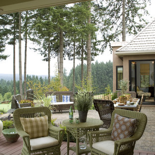 Elegant patio photo in Portland with decking and a roof extension