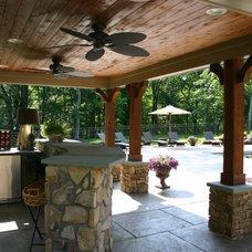 Tropical Patio by Budding Branch Landscape & Design