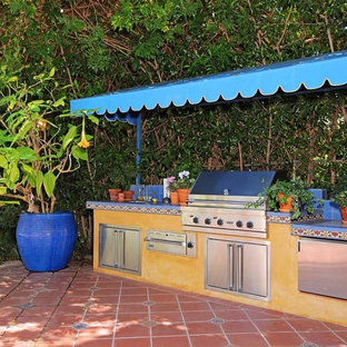 Patio kitchen - mediterranean tile patio kitchen idea in Los Angeles