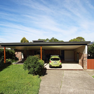 Inspiration for a huge front yard patio kitchen remodel in Sydney with decking and a roof extension