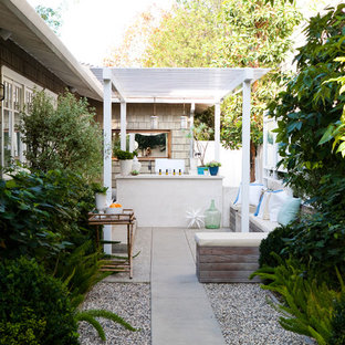 Elegant patio kitchen photo in Los Angeles with a pergola
