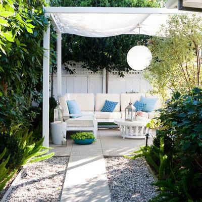 Elegant patio photo in Los Angeles with a gazebo