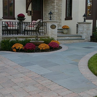 Inspiration for a small timeless front yard stone patio remodel in Chicago