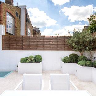 Idées déco pour une terrasse et balcon contemporaine avec aucune couverture.