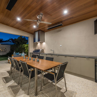 This is an example of a contemporary patio in Perth with an outdoor kitchen and a roof extension.