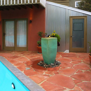 Inspiration for an eclectic stone patio remodel in Los Angeles with no cover