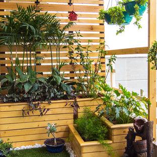 Foto di un piccolo patio o portico country