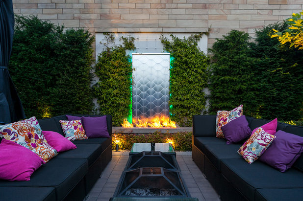 Eclectic Patio by Barnes Walker Ltd - Landscape Architects