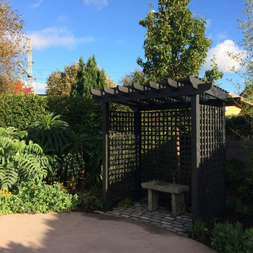Garden pergola within lush planting