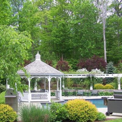 Patio - traditional backyard patio idea in New York with a gazebo
