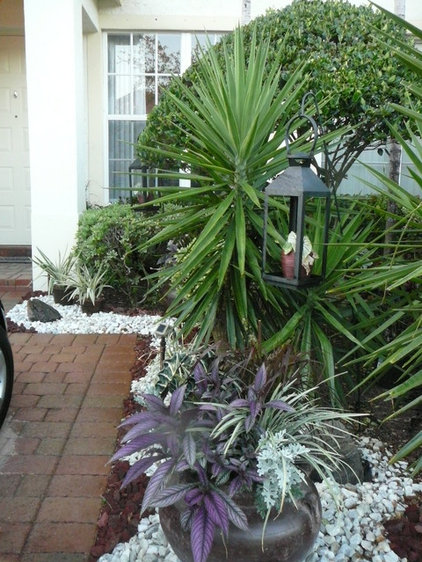 Eclectic Patio by FOCAL POINT STYLING
