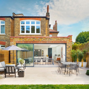 Design ideas for a medium sized contemporary back patio in London with no cover.