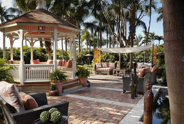 Tropical Patio by Interiors by Myriam, LLC