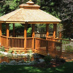 Patio - mid-sized traditional backyard patio idea in Toronto