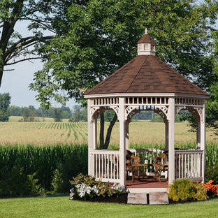 This is an example of a victorian patio in Other with a gazebo.