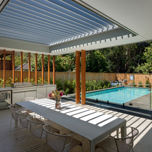 Inspiration for a mid-sized contemporary backyard patio in Sydney with an outdoor kitchen, a pergola and concrete slab.
