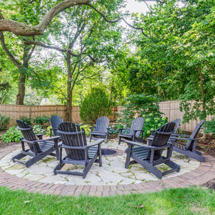 Inspiration for a large timeless backyard brick patio remodel in Chicago with a fire pit and no cover