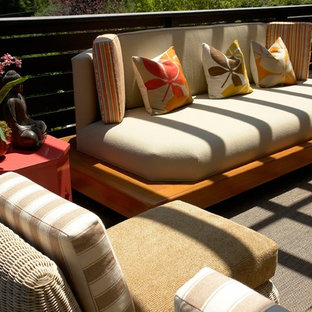 Example of a mid-sized zen backyard patio design in Los Angeles with decking and a roof extension