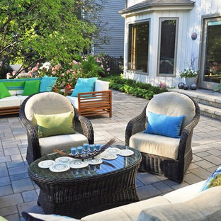 Inspiration for a large timeless backyard brick patio remodel in Chicago