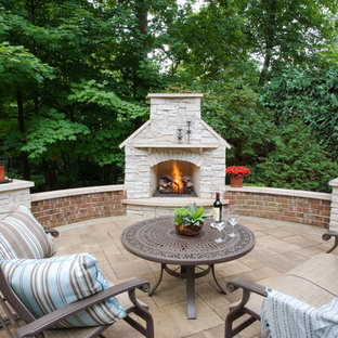 Inspiration for a timeless stone patio remodel in Chicago with a fire pit