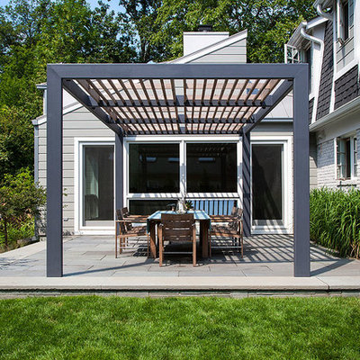 Inspiration for a contemporary patio remodel in Chicago with a pergola