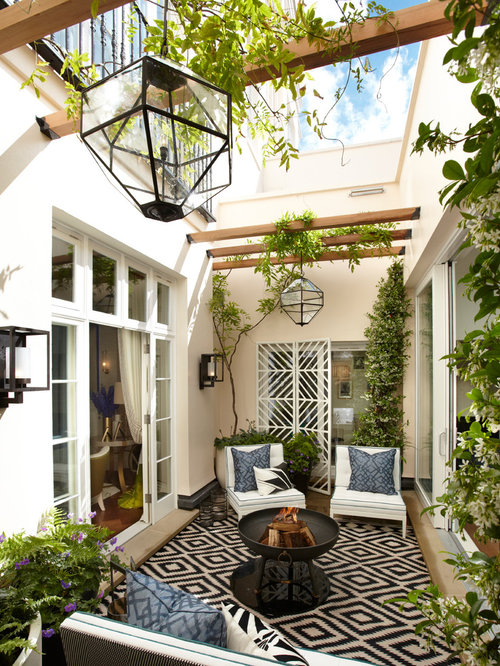 Tuscan Courtyard Patio Photo In London With A Fire Pit