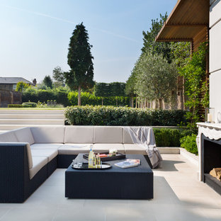 This is an example of a contemporary courtyard patio in London with no cover.