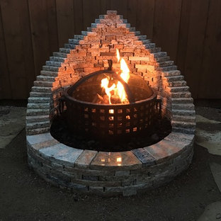 Patio - small craftsman backyard stone patio idea in Dallas with a fire pit and no cover