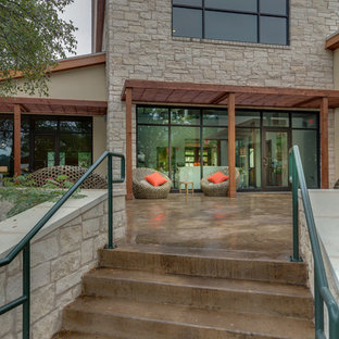 Example of a classic concrete patio design in Austin with a pergola