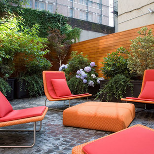 Example of a trendy backyard patio design in New York