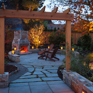 Photo of a traditional patio in Portland with a fire feature and a pergola.
