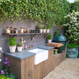 Idee per un patio o portico country di medie dimensioni con ghiaia e nessuna copertura