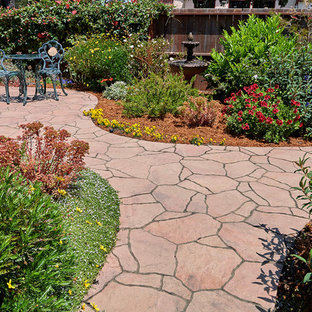 Design ideas for a small courtyard patio in San Francisco with a water feature, concrete pavers and no cover.