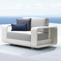 Hamptons Outdoor Wicker Lounge Chair - The Hampton outdoor wicker lounge chair features wide bands of outdoor wicker and deep seating cushions. A matching sectional sofa and coffee table are also available.